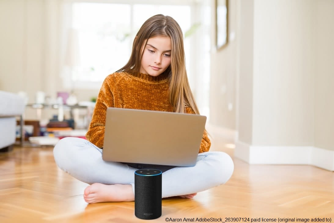 Girl using amazon echo alexa to work, rest and play